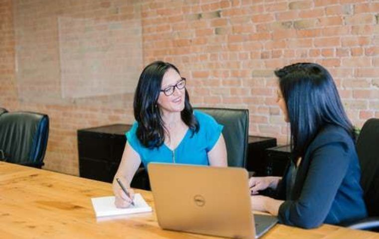Two women sitting having a meeting at a table