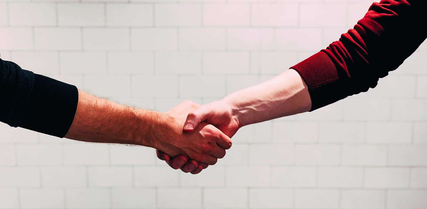 Image of two people shaking hands in agreement